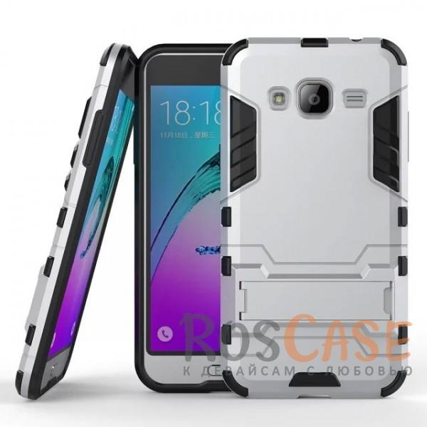 Ударопрочный чехол-подставка Transformer для Samsung J320F Galaxy J3 (2016) с мощной защитой корпуса (Серебряный / Satin Silver)Описание:подходит для Samsung J320F Galaxy J3 (2016);материалы: термополиуретан, поликарбонат;формат: накладка.&amp;nbsp;Особенности:функциональные вырезы;функция подставки;двойная степень защиты;защита от механических повреждений;не скользит в руках.<br><br>Тип: Чехол<br>Бренд: Epik<br>Материал: TPU