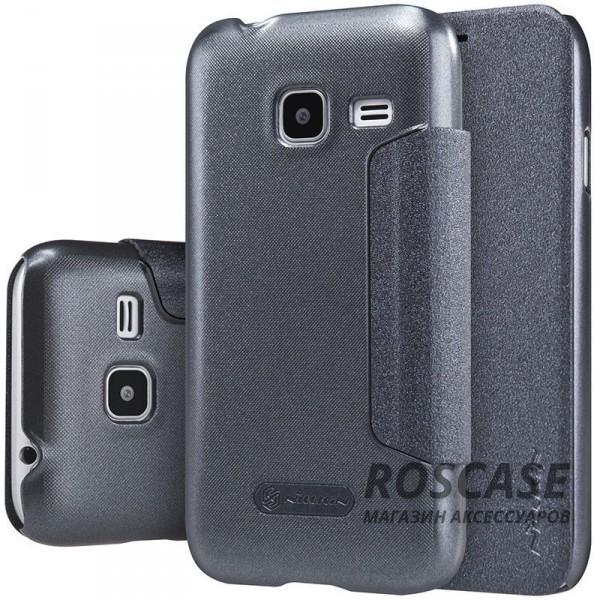 Кожаный чехол (книжка) Nillkin Sparkle Series для Samsung J105H Galaxy J1 Mini / Galaxy J1 Nxt (Черный)Описание:бренд&amp;nbsp;Nillkin;изготовлен специально для Samsung J105H Galaxy J1 Mini / Galaxy J1 Nxt;материал: искусственная кожа, поликарбонат;тип: чехол-книжка.Особенности:не скользит в руках;защита от механических повреждений;не выгорает;блестящая поверхность;надежная фиксация.<br><br>Тип: Чехол<br>Бренд: Nillkin<br>Материал: Искусственная кожа