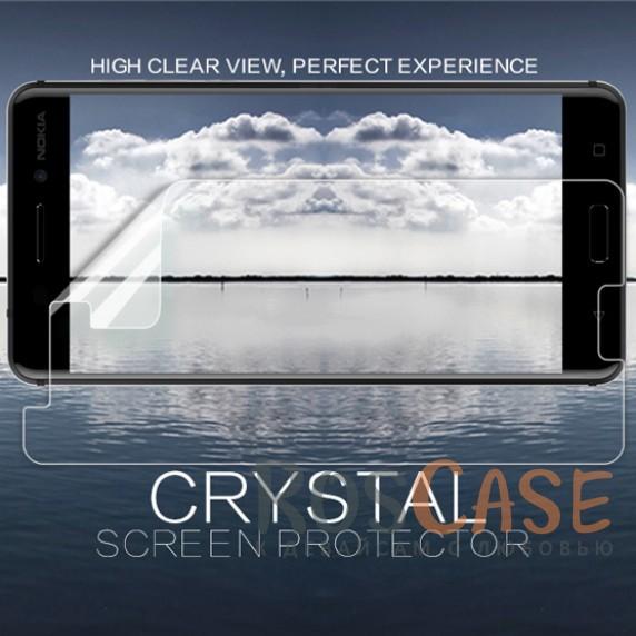 Прозрачная глянцевая защитная пленка на экран с гладким пылеотталкивающим покрытием для Nokia 6Описание:бренд&amp;nbsp;Nillkin;совместимость - Nokia 6;материал: полимер;тип: прозрачная пленка;ультратонкая;защита от царапин и потертостей;фильтрует УФ-излучение.<br><br>Тип: Защитная пленка<br>Бренд: Nillkin