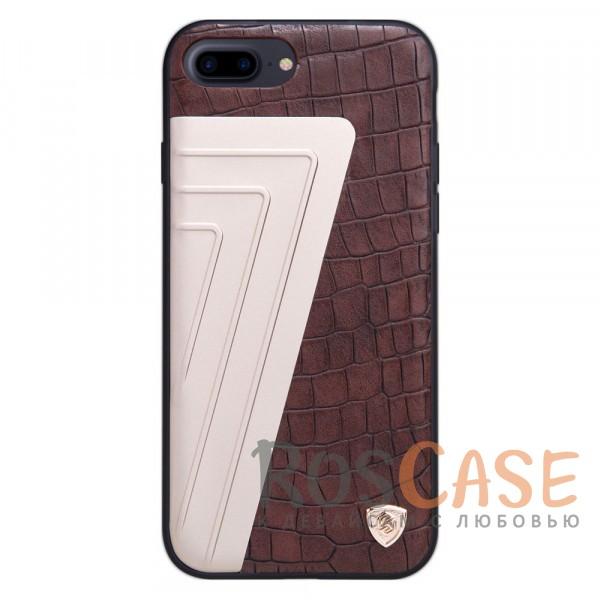 Кожаная накладка Nillkin Hybrid Series для Apple iPhone 7 plus (5.5) (Коричневый)Описание:произведено брендом&amp;nbsp;Nillkin;совместимость - Apple iPhone 7 plus (5.5);материалы: поликарбонат, термополиуретан, металл, искусственная кожа;тип: накладка.&amp;nbsp;Особенности:оригинальный дизайн;вставка с фактурой крокодиловой кожи;двухцветный стиль;анти-отпечатки;не скользит в руках;защищает заднюю панель и боковые грани.<br><br>Тип: Чехол<br>Бренд: Nillkin<br>Материал: Натуральная кожа