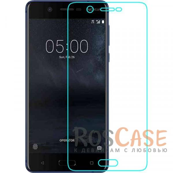 Тонкое гладкое защитное стекло Mocolo с олеофобным покрытием для Nokia 5 (Прозрачное)Описание:производитель - Mocolo;разработано для Nokia 5;защита экрана от ударов и царапин;олеофобное покрытие анти-отпечатки;ультратонкое;высокая прочность 9H;не разлетается на кусочки при разбивании;закругленные срезы 2,5D;устанавливается за счет силиконового слоя.<br><br>Тип: Защитное стекло<br>Бренд: Mocolo